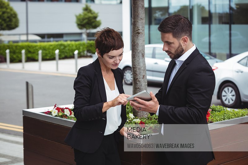 Businesspeople discussion on digital tablet in office building
