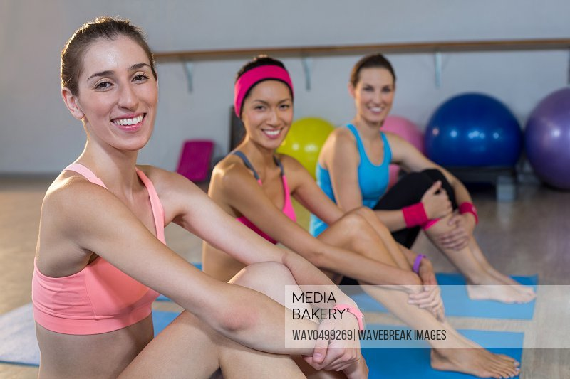 Group of beautiful women smiling in gym