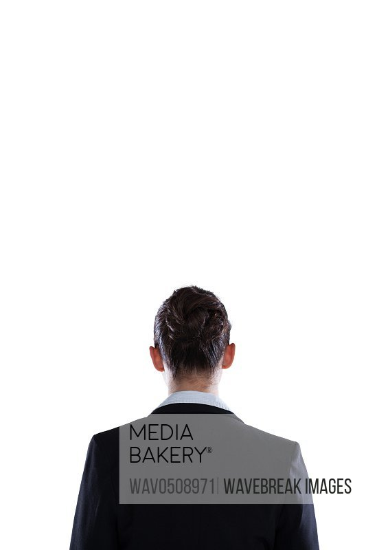 Businesswoman standing against white background