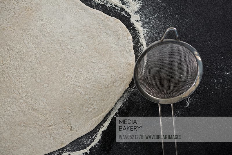 Pizza dough with tea strainer