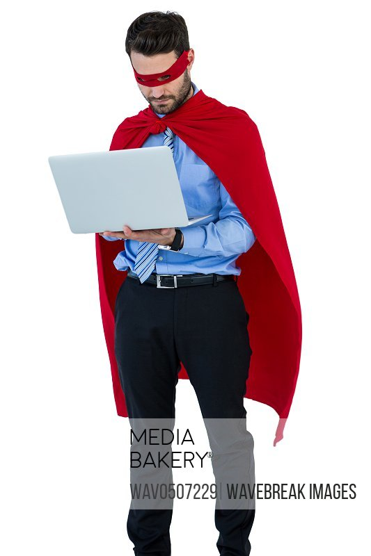 Businessman pretending to be a super hero using laptop on white background