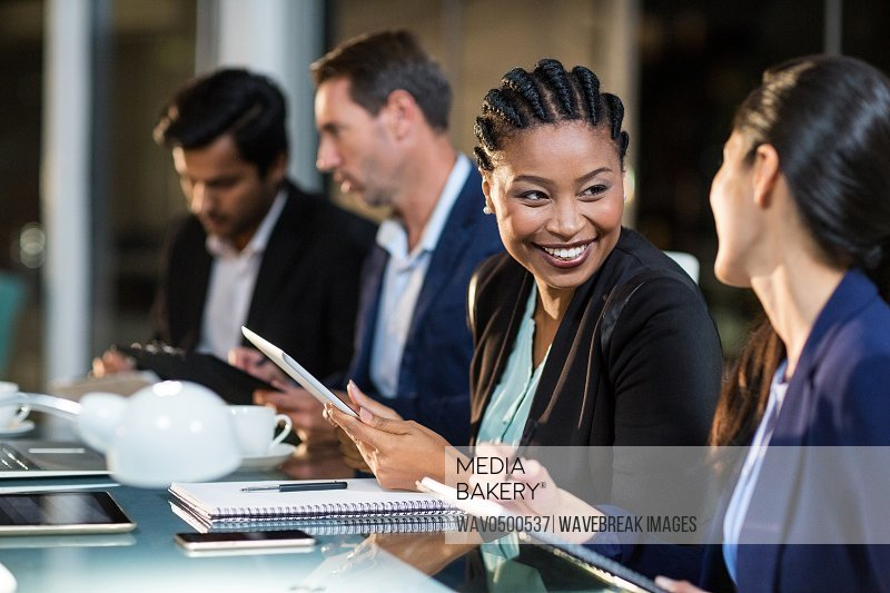 Businesswoman interacting with a colleague in the office