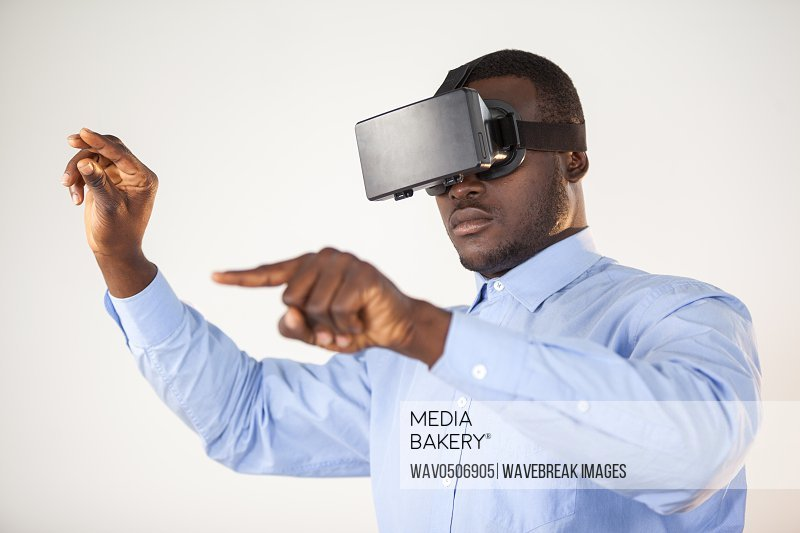 Man using virtual reality headset against white background