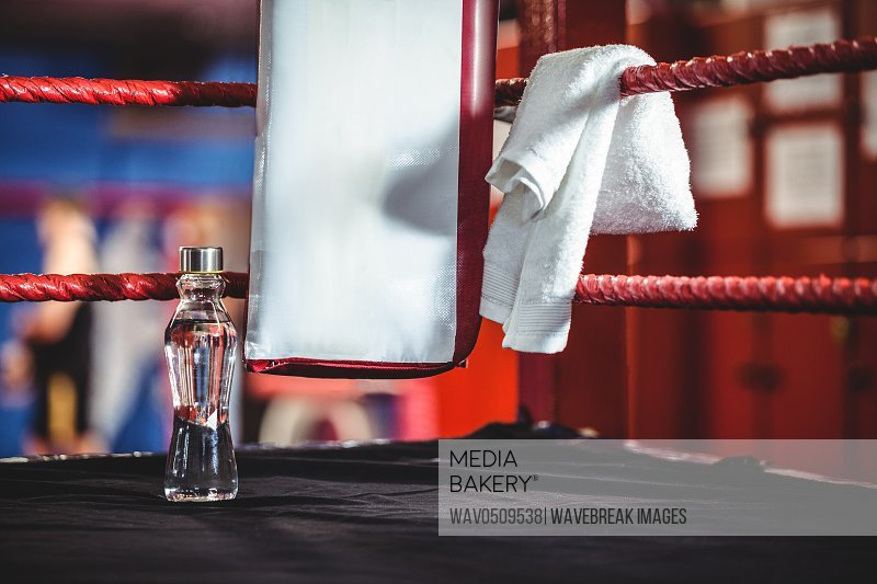Water bottle and a towel in the corner of boxing ring
