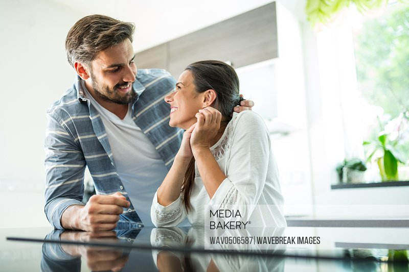 Romantic couple looking at each other in kitchen