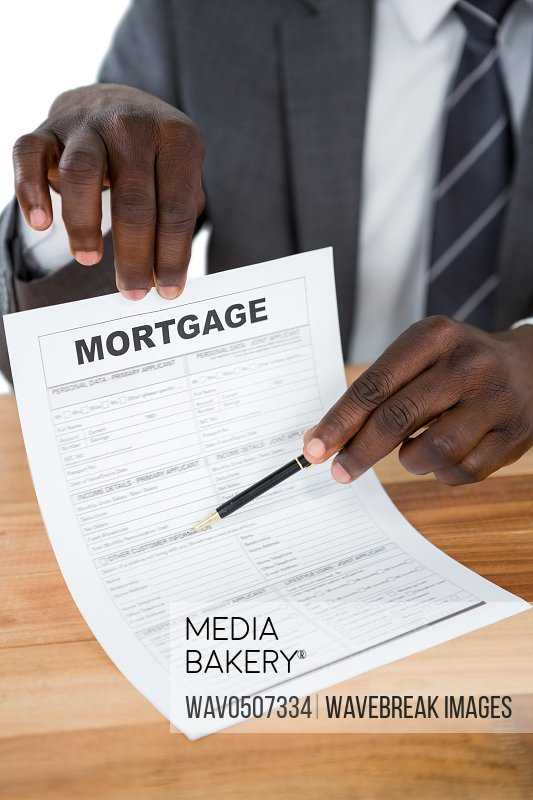 Mid section of businessman showing mortgage document
