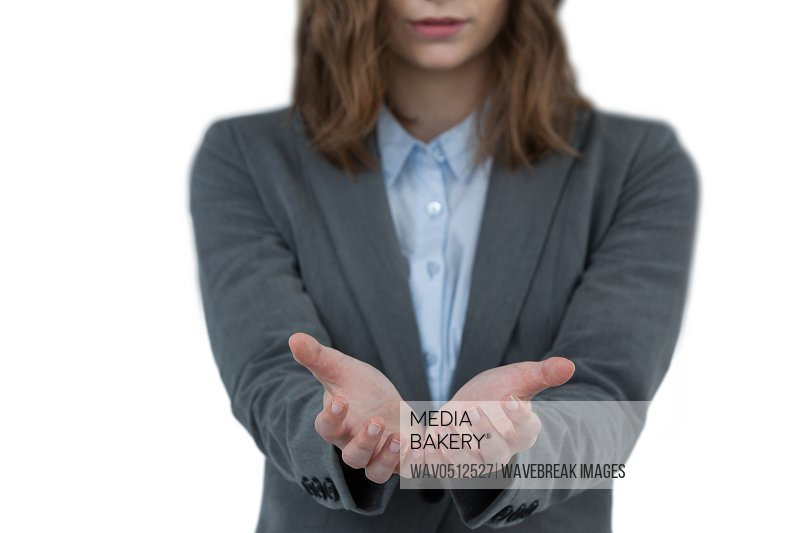 Close-up of businesswoman gesturing against white background