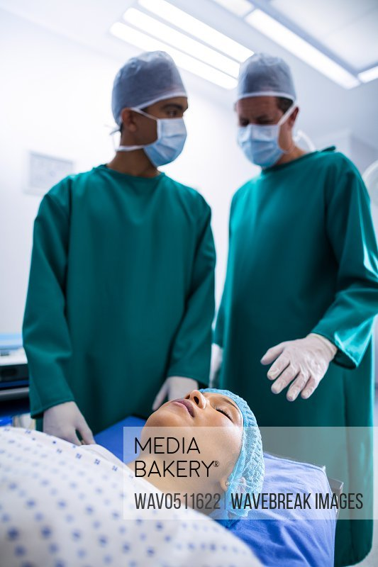Surgeons operating in operation theater in hospital