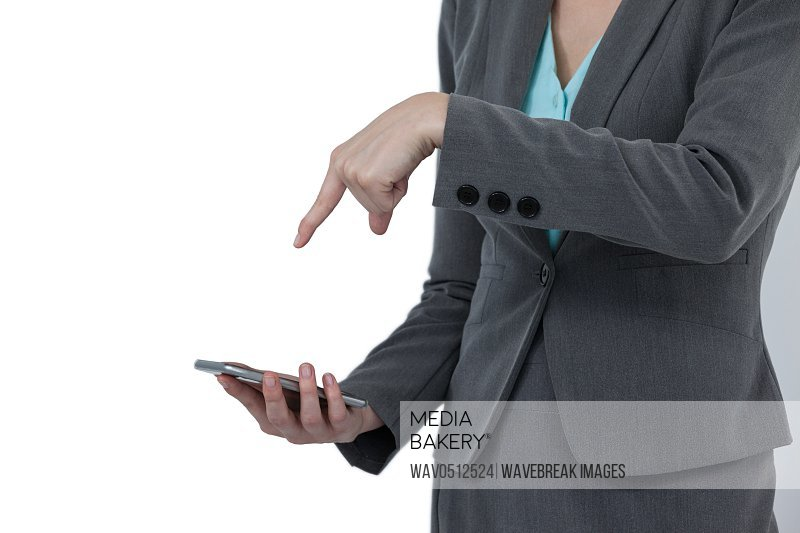 Mid section of businesswoman using mobile phone against white background