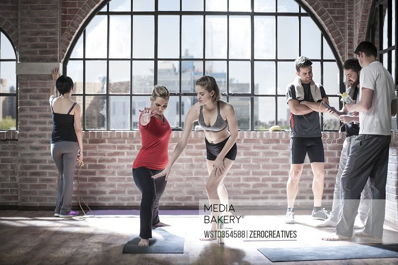 Woman instructing yoga class