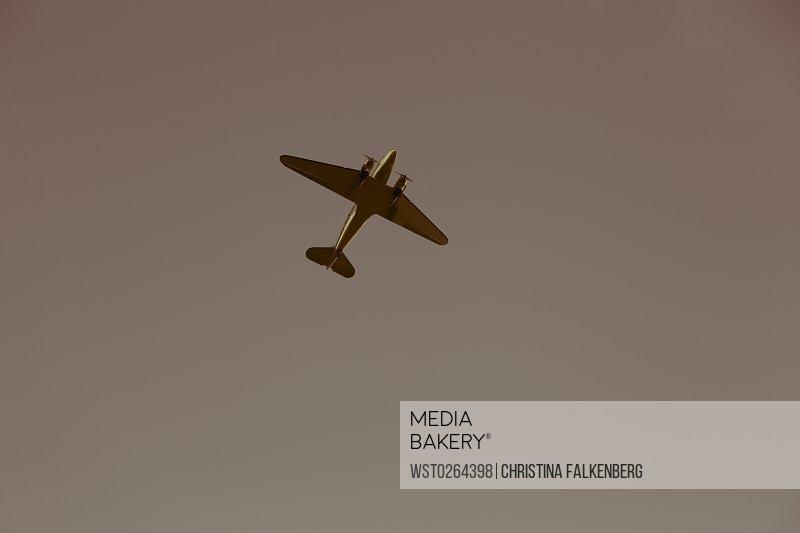 Finland, Propeller plane flying in the sky