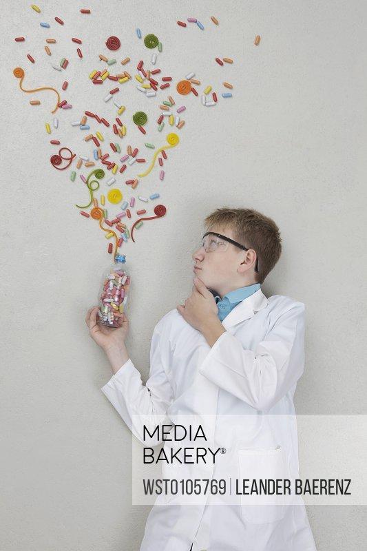 Teenage boy doing experiment