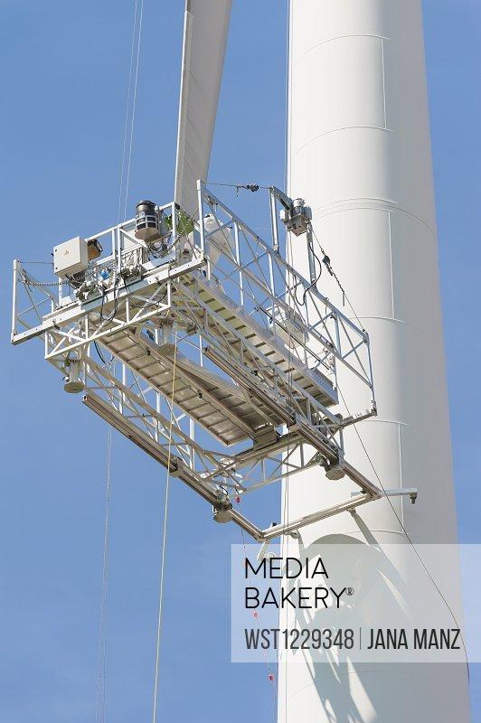 Germany, Saxony, Maintenance lift of wind turbine against sky