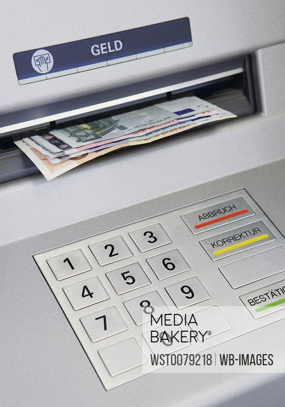 Close up of cash machine with notes