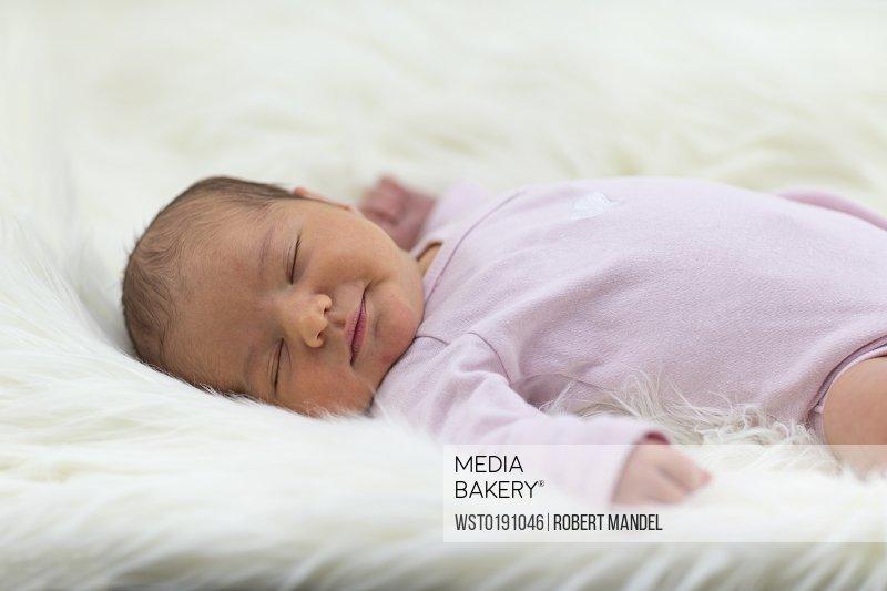 Mediabakery Photo By Westend 61 Newborn Baby Girl Sleeping On Sheepskin