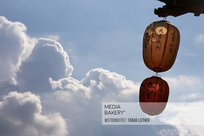 Chinese lanterns against cloudy sky
