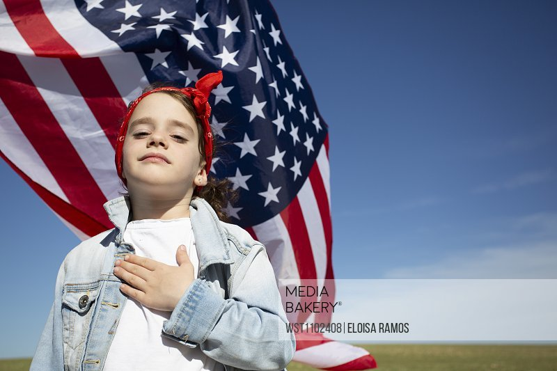 Portrait of proud girl with American flag