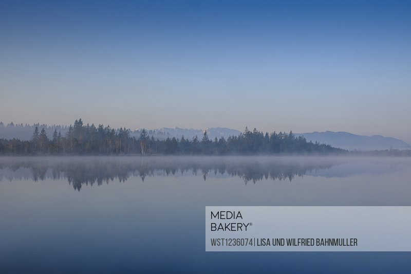 Kirchsee lake at foggy dawn