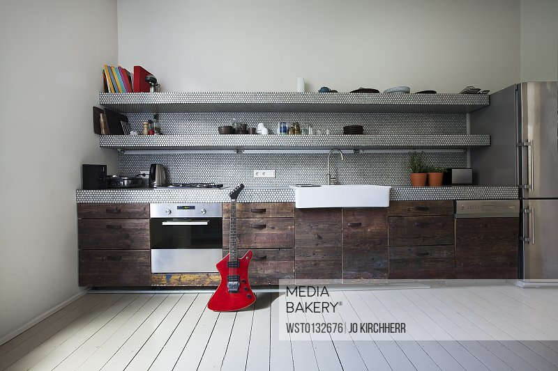 Interior of kitchen with electric guitar