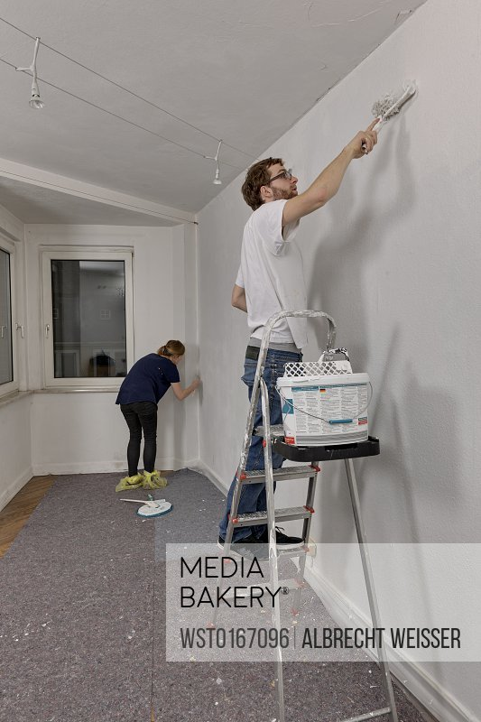 Young couple renovating new apartment
