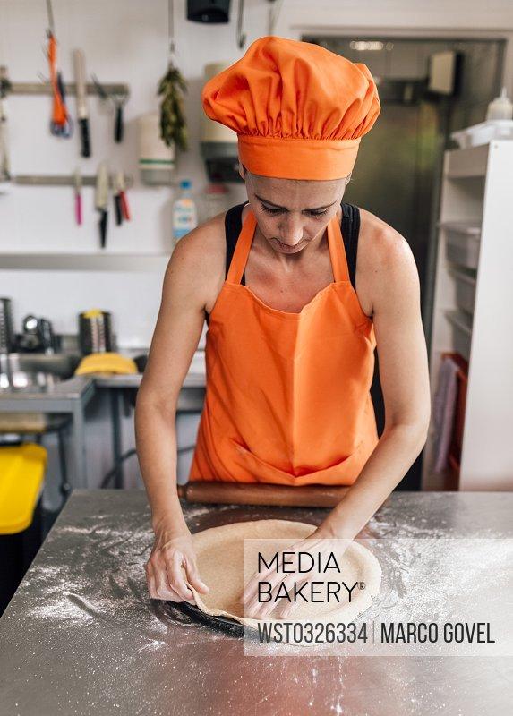 Pizza baker preparing dough