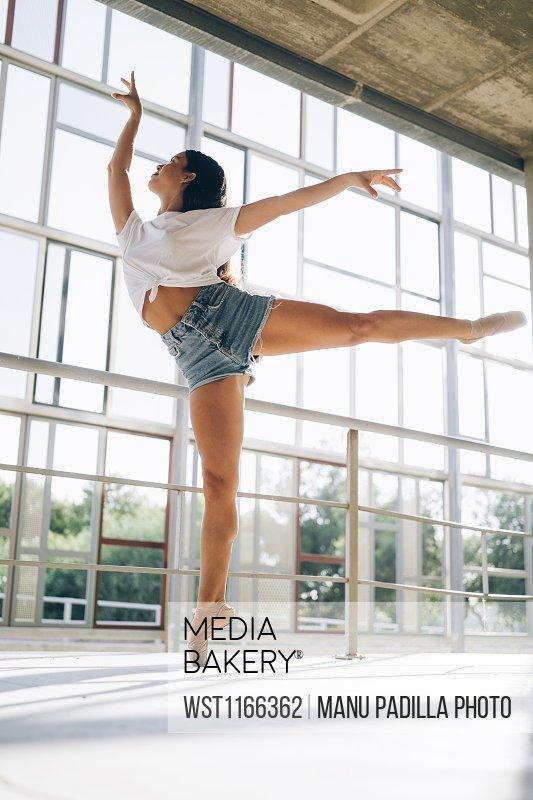 Ballerina dancing in gym