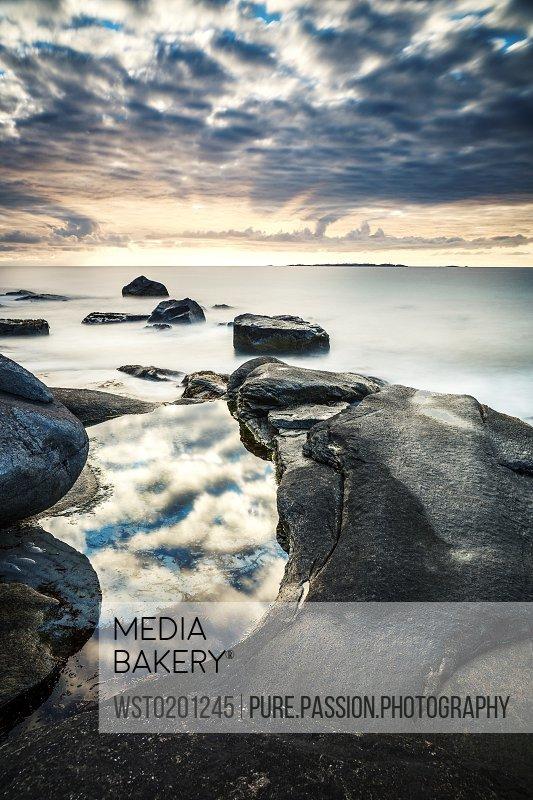 Scandinavia Norway Lofoten Vestvagoy Sundown at the coastline of Utakleiv