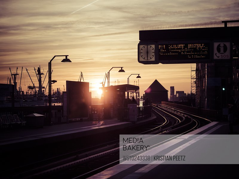 Germany, Hamburg, underground station Baumwall at sunset, Port of Hamburg in the background<br><br><span style='color: red'>Editorial Use Only.</span><br><br>