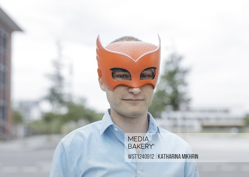 Man wearing mask standing in city
