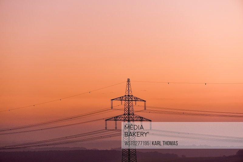 Austria, Burgenland, high-voltage pole in the evening