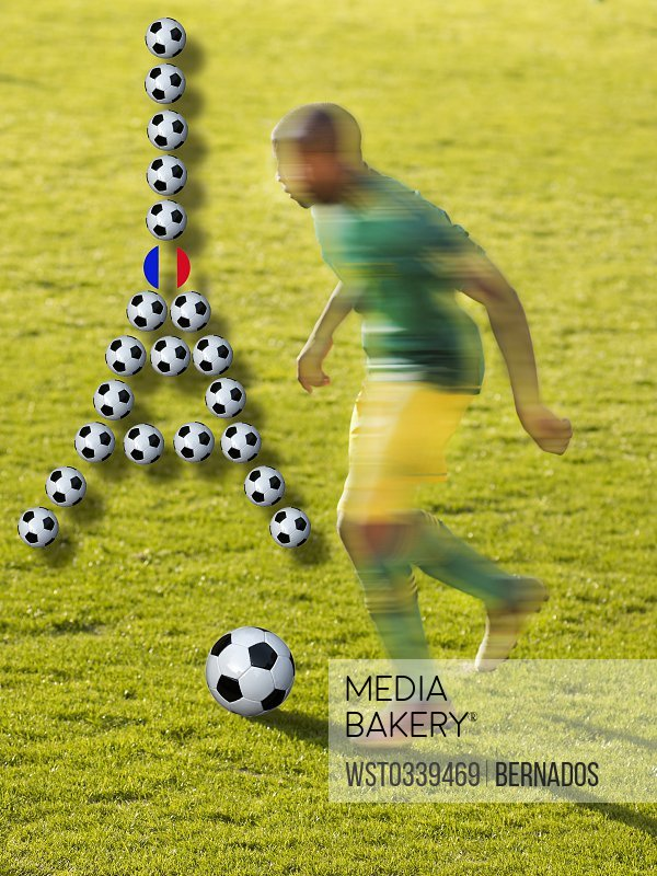 Soccer player and Eiffel Tower made of soccer balls, composite<br><br><span style='color: red'>Editorial Use Only.</span><br><br>
