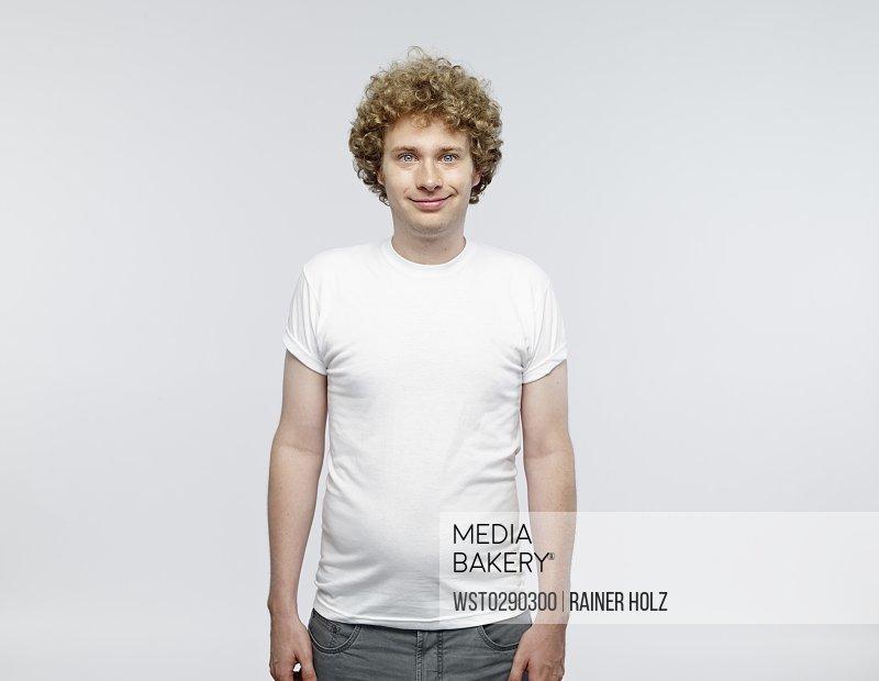 Portrait of smiling blond man wearing white t-shirt