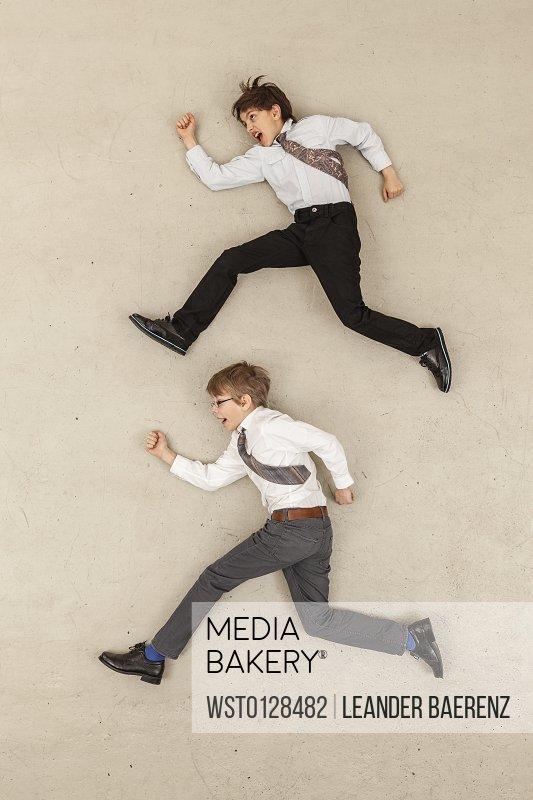 Business boys running in opposite direction