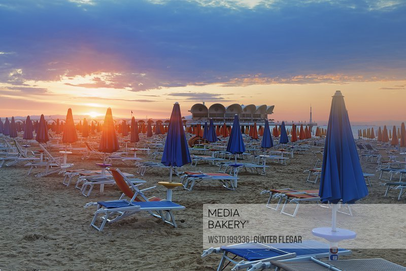 Photo By Westend 61 Italy Friuli Venezia Giulia Province Of Udine Lignano Sabbiadoro Beach With Sun Loungers In The Evening Terrazza A Mare In The