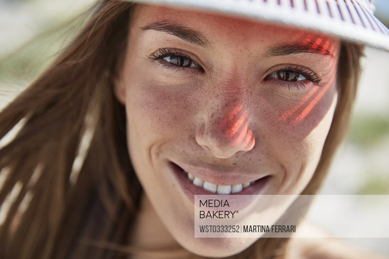 7f44855c Mediabakery - Photo by Westend 61 - Portrait of smiling young woman ...