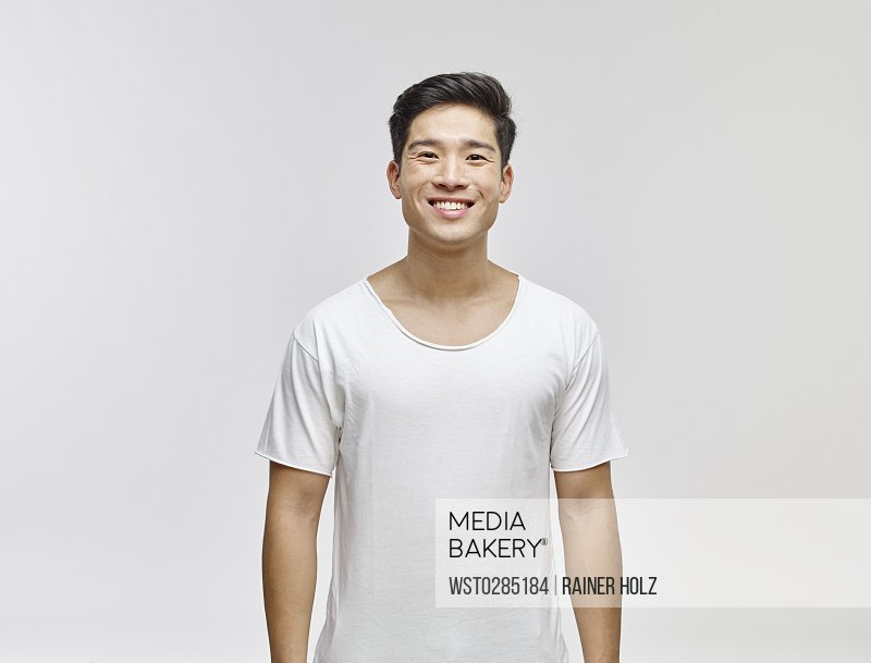 Portrait of smiling young man wearing white t-shirt