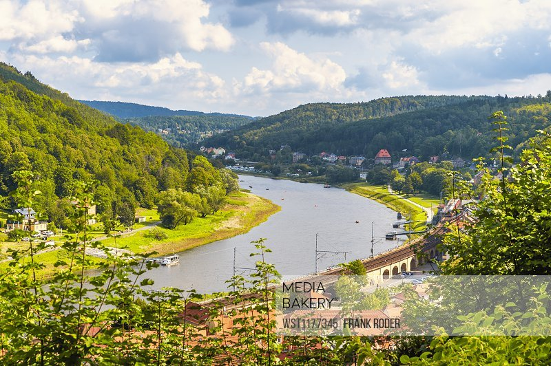 Germany, Saxony, Konigstein, Riverside town and forested hills of Elbe Valley