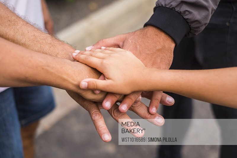 Family stacking hands, close-up
